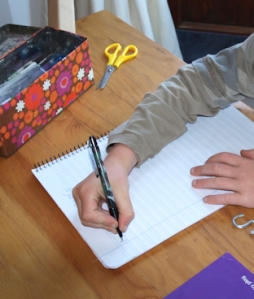 Photo of child doing some creative writing