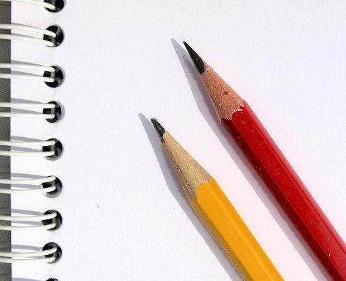 writing pencils on pad
